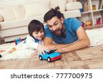 father has fun with his son. an ... | Shutterstock . vector #777700975