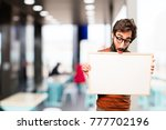 young cool man with a placard | Shutterstock . vector #777702196