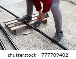 man is cutting black metal... | Shutterstock . vector #777709402