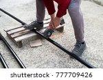 man is cutting black metal... | Shutterstock . vector #777709426