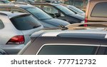 Totally overfull parking lot - stock photo