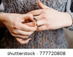 woman takes off an engagement... | Shutterstock . vector #777720808