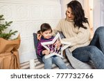 beautiful caucasian mom and... | Shutterstock . vector #777732766