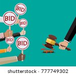 hands holding auction paddle... | Shutterstock .eps vector #777749302