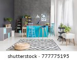 plant on white cabinet and pouf ... | Shutterstock . vector #777775195
