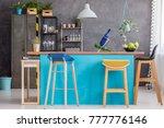 wooden stools at blue kitchen... | Shutterstock . vector #777776146