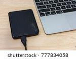 external hard disk on laptop.  ... | Shutterstock . vector #777834058