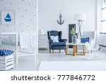 white kid's bed in bright room... | Shutterstock . vector #777846772