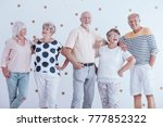 old friends meeting. smiling... | Shutterstock . vector #777852322