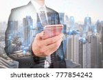 Small photo of Double exposure of businessman use smartphone, communication 4G 5G node networking telephone cellsite and cityscape urban at foggy morning as business, technology and telecom concept