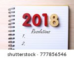 year 2018 resolutions on notepad | Shutterstock . vector #777856546