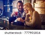 evening at the bar. romantic... | Shutterstock . vector #777901816