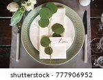 plate with a guest card signed... | Shutterstock . vector #777906952