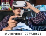 young man using virtual reality ... | Shutterstock . vector #777928636