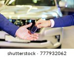 the sales manager hands over... | Shutterstock . vector #777932062