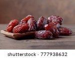 juicy dates in a bowl on a old... | Shutterstock . vector #777938632
