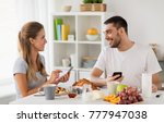 technology  eating and people... | Shutterstock . vector #777947038