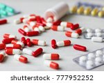medications and pills scattered ... | Shutterstock . vector #777952252