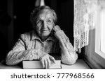 elderly woman with a book near... | Shutterstock . vector #777968566
