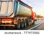 dump truck goes in the evening... | Shutterstock . vector #777973582