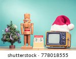 retro tv in santa's hat ... | Shutterstock . vector #778018555