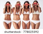 Stock photo group of young sexy multiracial women in white lingerie are posing on white background with red 778025392