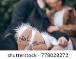 the bride and groom are kissing ... | Shutterstock . vector #778028272