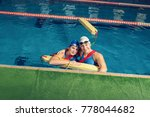 two trainers team in a pool... | Shutterstock . vector #778044682