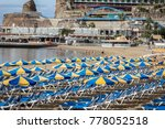 rows of blue sunbeds with blue... | Shutterstock . vector #778052518