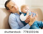exhausted parent. cute little... | Shutterstock . vector #778103146