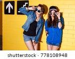 Two Happy Girls Wearing Stylis...