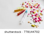 ampoules and syringe on white... | Shutterstock . vector #778144702