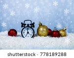 clock in a santa hat and balls... | Shutterstock . vector #778189288