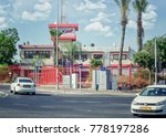Small photo of Rishon LeZion, Israel-June 17, 2017: Fire department headquarter of the city is placed in two story red-white building with watching tower behind wrought iron fence nearby Moshe Dayan Boulevard