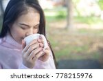 female hands holding cups of... | Shutterstock . vector #778215976