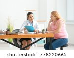 young female doctor consulting... | Shutterstock . vector #778220665