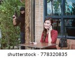 robber thief holding gun and...   Shutterstock . vector #778320835