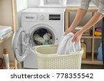 woman doing laundry at home | Shutterstock . vector #778355542