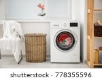 laundry in washing machine and... | Shutterstock . vector #778355596