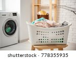 basket with laundry on stool... | Shutterstock . vector #778355935