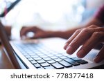 man working by using a laptop... | Shutterstock . vector #778377418
