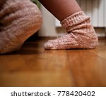 child's foot in a knitted sock... | Shutterstock . vector #778420402