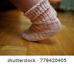 child's foot in a knitted sock... | Shutterstock . vector #778420405