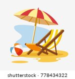 umbrella and sun lounger on the ... | Shutterstock .eps vector #778434322
