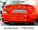 Small photo of MANILA, PH - NOV. 30: Red BMW M4 rear view at Manila Auto Salon on November 30, 2017 in Manila, Philippines. Manila Auto Salon is a annual gathering exhibit for automotive aftermarket industry.