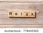 Relax Word Written On Wood...