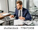 handsome tax manager dressed in ... | Shutterstock . vector #778472458