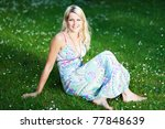 young woman in a summer dress on a lawn - stock photo