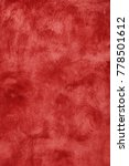 Small photo of Grunge burgundy red vivid uneven old aged daub plaster wall texture background with stains and paint strokes, close up