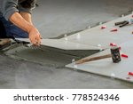 ceramic tiles. tiler placing... | Shutterstock . vector #778524346